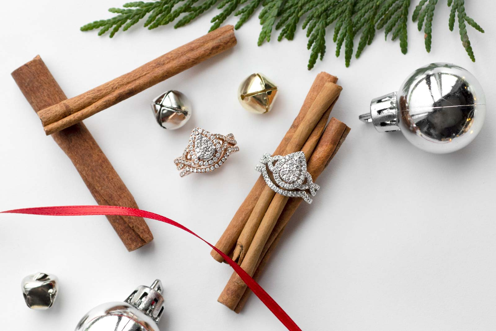 Holiday themed flat lay photo with engagement rings edited
