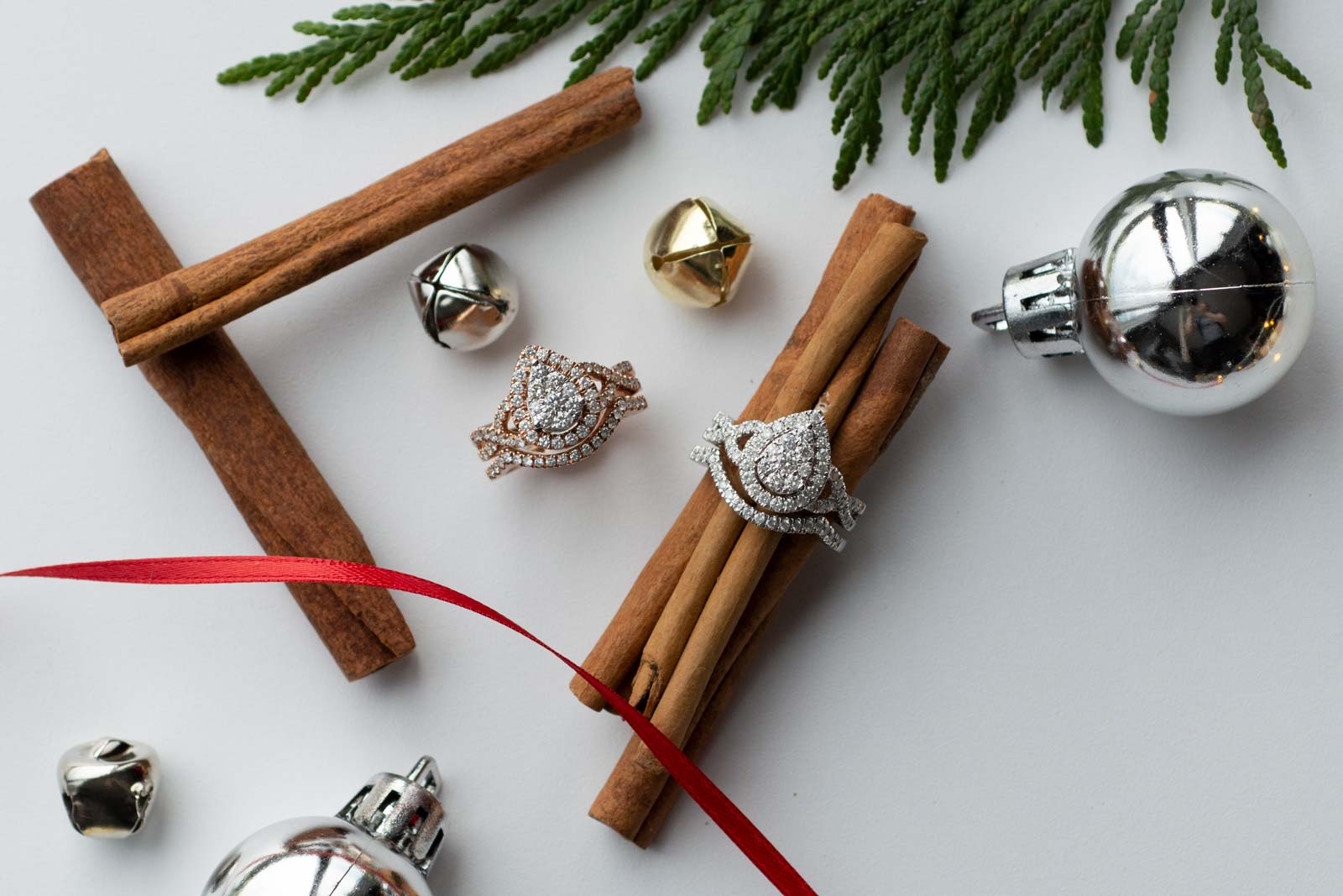 Holiday themed flat lay photo with engagement rings unedited